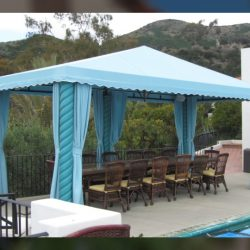 Pool cabana with light blue awning fabric