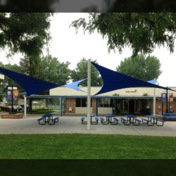 Blue commercial sun shade panels for a patio