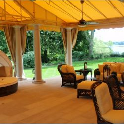 Large patio shade awning with yellow awning fabric