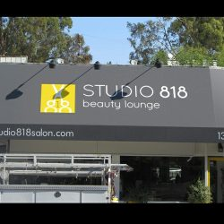 Custom storefront awning with black awning fabric for Studio 818