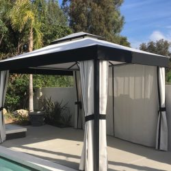 Small cabana with custom black and white awning fabric