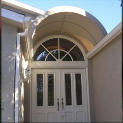 Residential entrance awning with tan awning fabric
