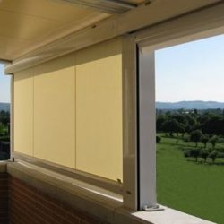 Residential drop-roll awning shade with yellow awning fabric