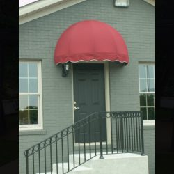 Red dome awning on a green house