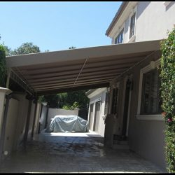 Metal carport awning on the side of a home