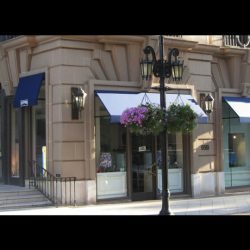 Blue window awnings with custom awning graphics in Van Nuys