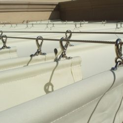Close up of a slide on wire awning with white awning fabric