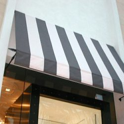 Spearhead awning with striped grey and white awning fabric