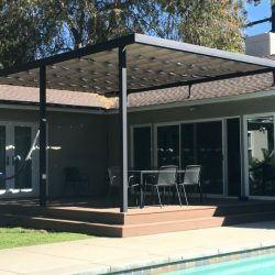 Dark residential slide on wire awning with white awning fabric