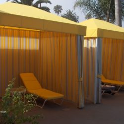 Commercial cabanas with yellow and white custom awning fabric