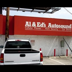 Custom awning for Al & Ed's Autosound with custom awning graphics