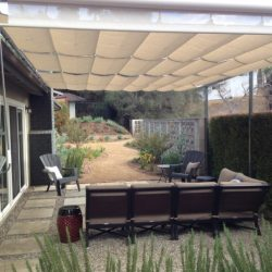 Residential slide on wire awning with tan awning fabric