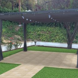 Dark metal awning with dark slide on wire awning fabric