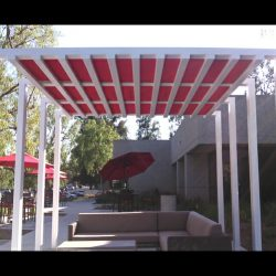 White commercial trellis cover with red awning fabric