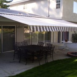 Residential retractable awning with striped awning fabric