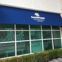 Blue window awning with white awning graphics for Bauerfeind