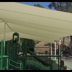 Large olive tension shade for a playground