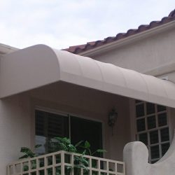 Tan awning fabric on a residential porch awning