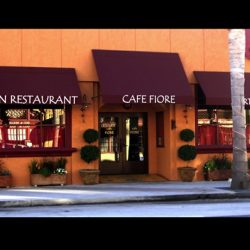 Maroon storefront awning with white awning graphics for Cafe Fiore