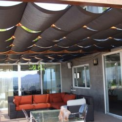 Residential slide on wire awning with dark awning fabric