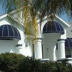 Dome awnings with navy blue and white awning fabric