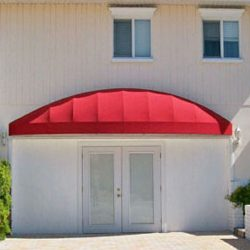 Residential awning with red awning fabric