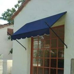 Residential spearhead awning with blue awning fabric