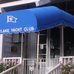 Blue and white awning fabric on a custom walkway awning for Westlake Yacht Club