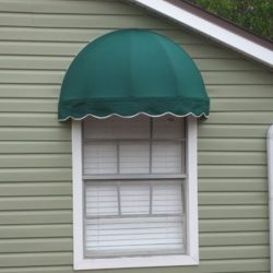 Residential dome awning with green and white awning fabric