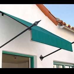 Residential spearhead awning design with green awning fabric