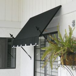 Spearhead awning with dark awning fabric