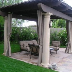 Dark residential trellis cover with custom drapes