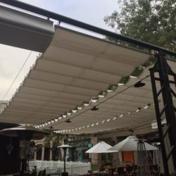Metal awning with white slide on wire awning fabric