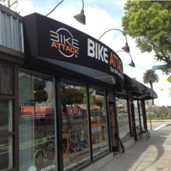 Black storefront awnings for Bike Attack