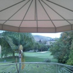 Commercial patio shade awning with tan awning fabric for a gold course