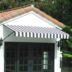 Black and white striped awning fabric on a custom spearhead awning