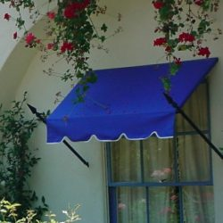 Blue awning fabric with custom spearhead awning