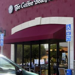 Red commercial awning for The Coffee Bean