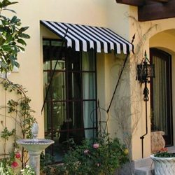 Residential doorway spearhead awning with striped awning fabric