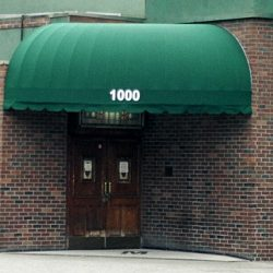 Custom commercial awning with green awning fabric