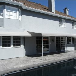 Light grey patio shade awnings for a pool area
