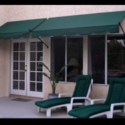 Green awning fabric with custom spearhead awning