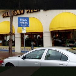 Commercial window dome awnings with yellow awning fabric