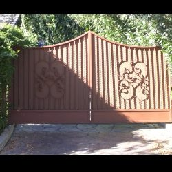 Rusty colored custom fabric covers for an entry gate