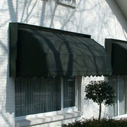Forrest green awning fabric on custom residential awnings