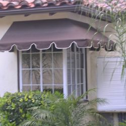 Custom residential window awning with brown awning fabric