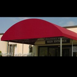 Red awning fabric on a cusotm walkway awning
