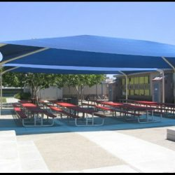 Metal tension shade with blue awning fabric