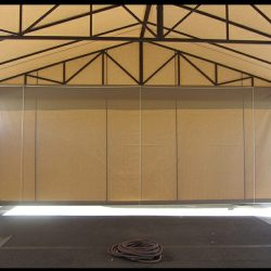 Tan carport awning with drop-roll awning cover