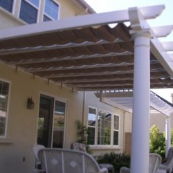 White trellis cover with dark slide waire awning fabric